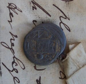 Theodore's lead token, bearing the number 15514